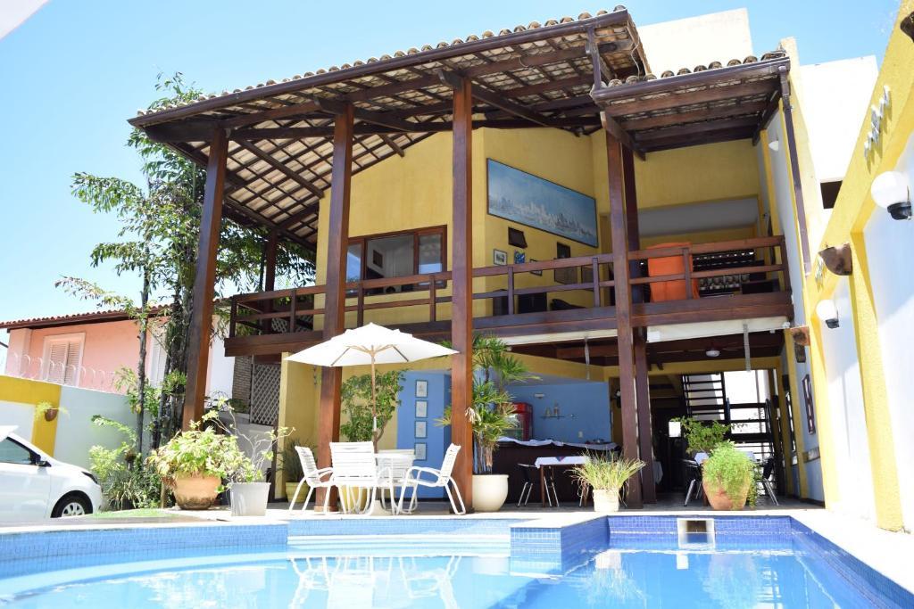 The swimming pool at or near Hotel Pousada Encanto de Itapoan