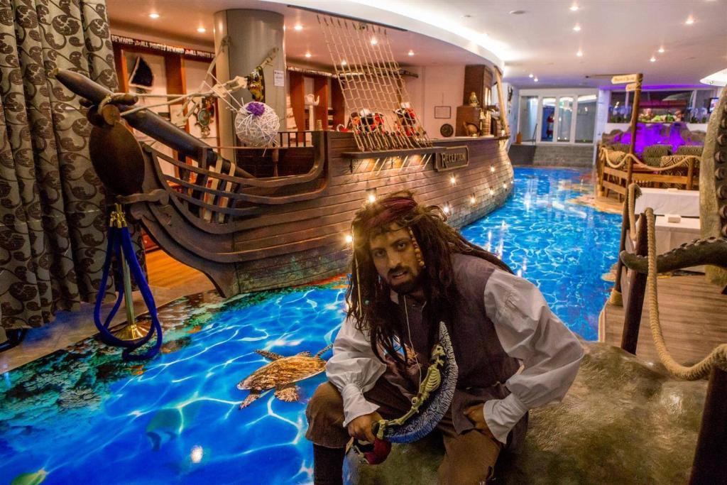 The swimming pool at or near Bicaz - Pirates Resort