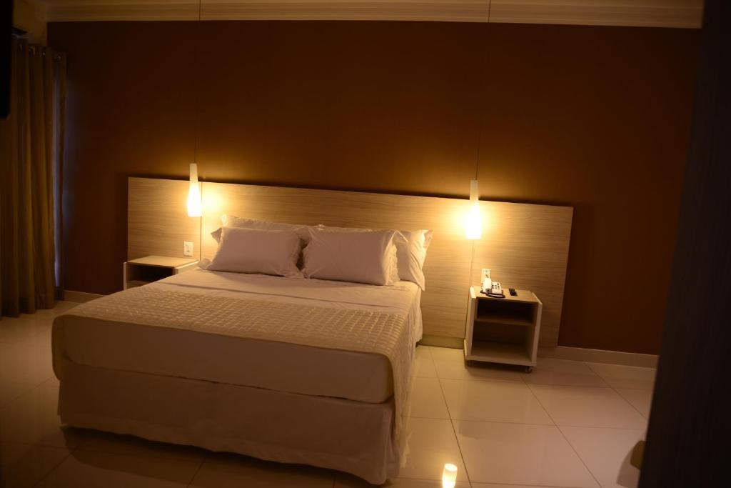Кровать или кровати в номере Granterrara Hotel