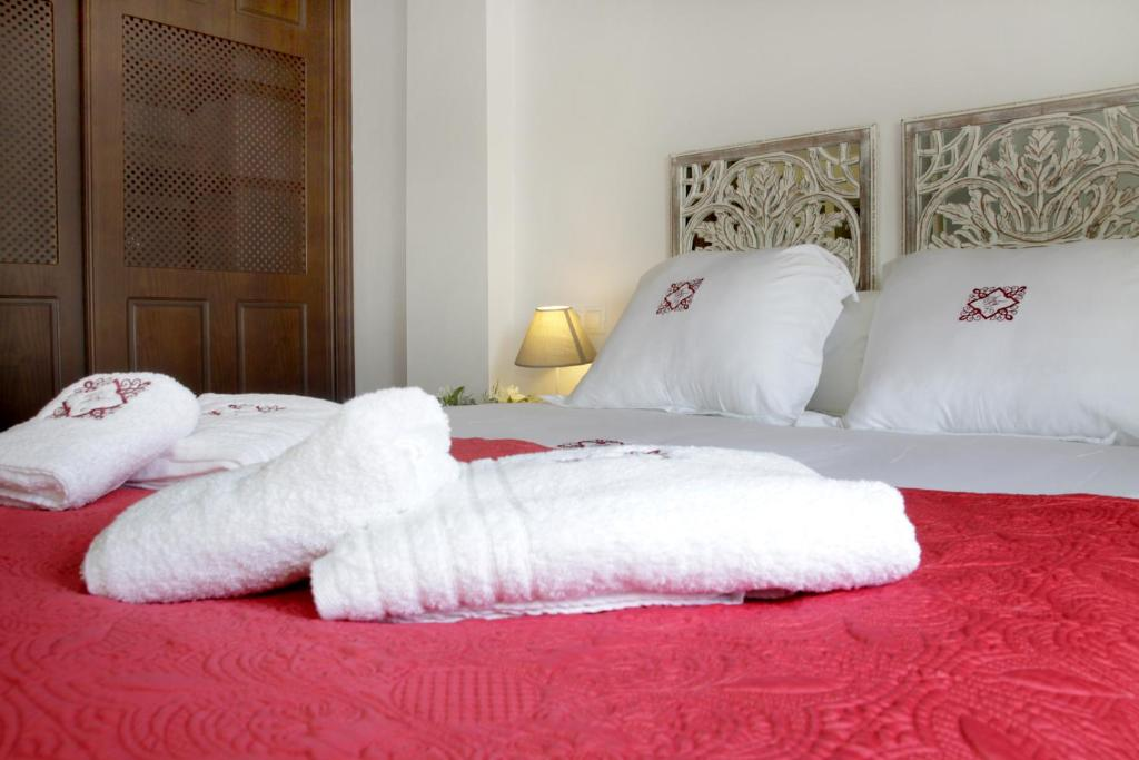 Cama o camas de una habitación en Apartamentos San Fernando 76