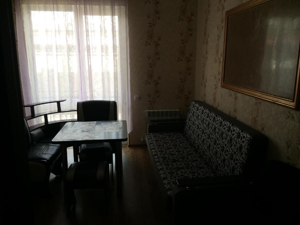 A seating area at Apartment Kabardinskiy pereulok