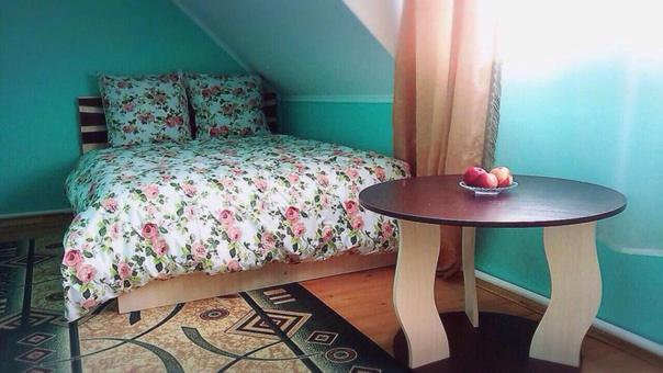 Кровать или кровати в номере 1 Gostiniy Dvor Izbushka