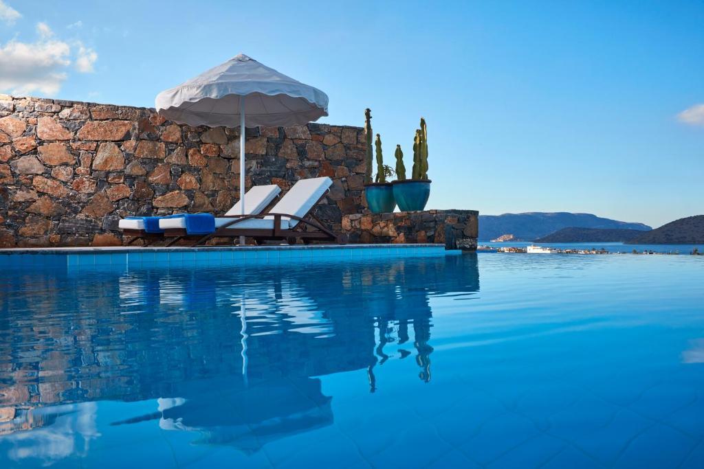 Πισίνα στο ή κοντά στο Elounda Palm Hotel & Suites