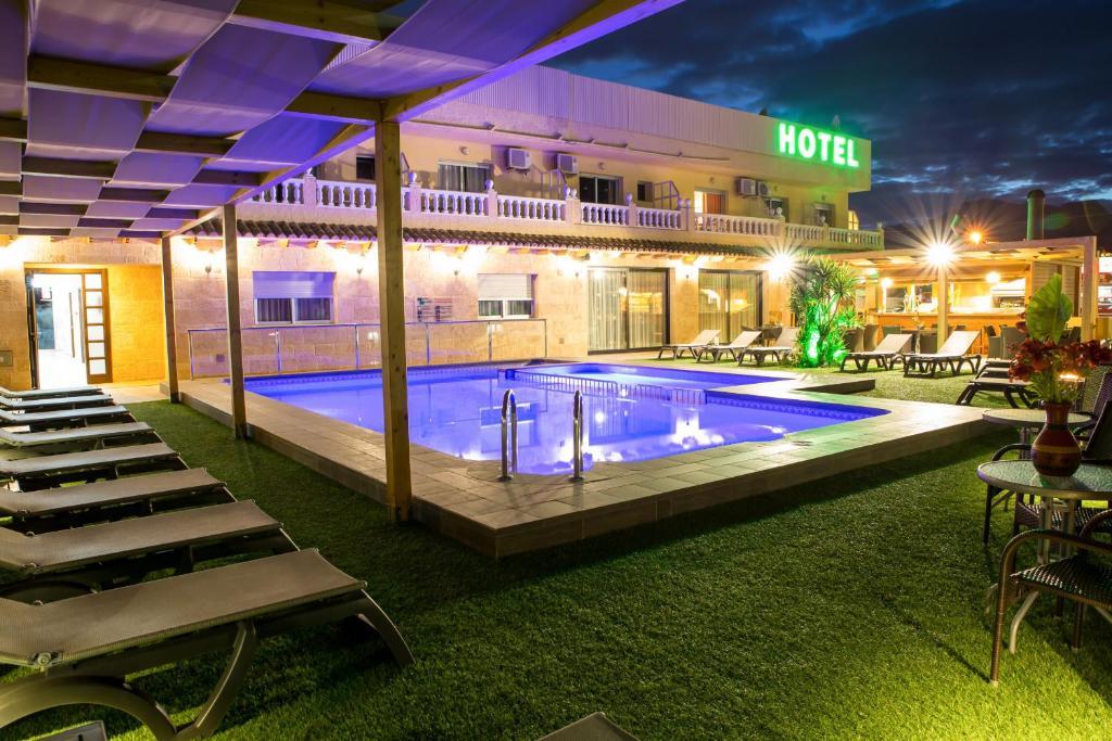 The swimming pool at or near Hotel Noguera El Albir