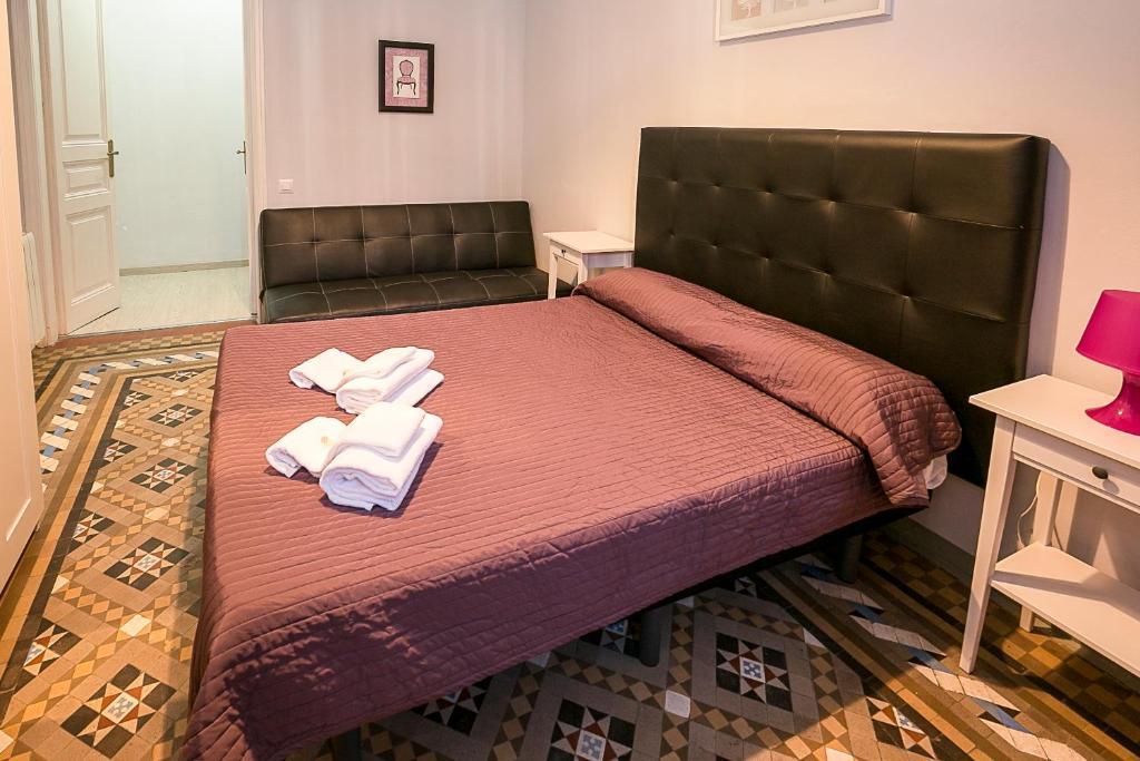 Ein Bett oder Betten in einem Zimmer der Unterkunft Hostal Balmes Centro