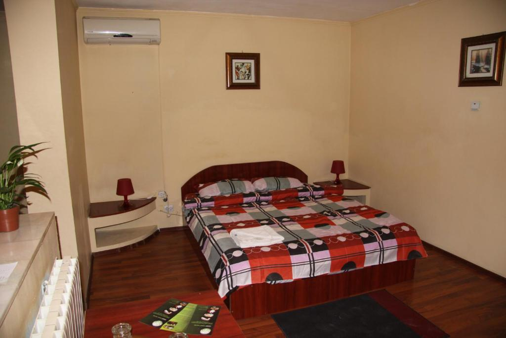 A bed or beds in a room at Hotel Casa Verde Prosper