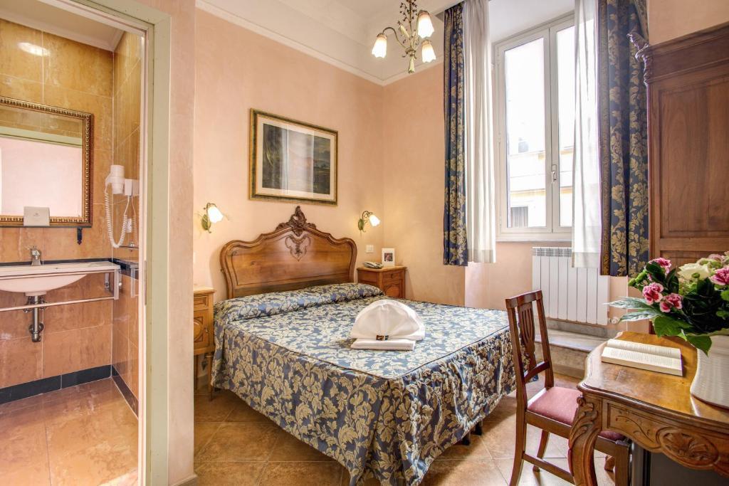 Кровать или кровати в номере Hotel Caravaggio