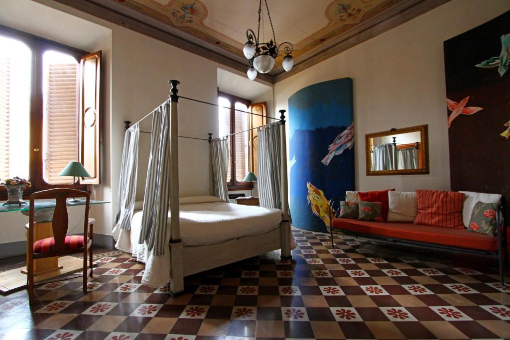 A bunk bed or bunk beds in a room at B&B Canto Alla Porta Vecchia