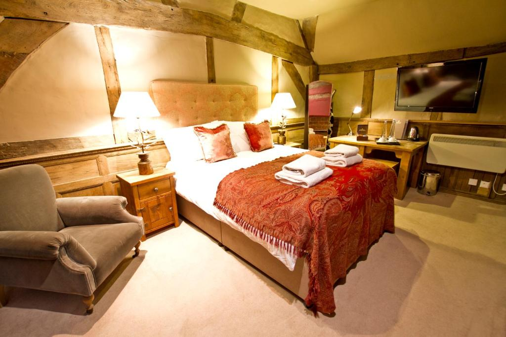 A bed or beds in a room at Chapter House