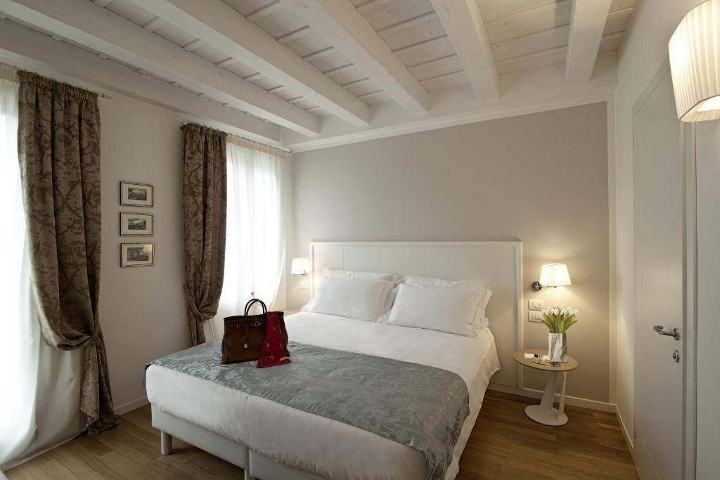 Cama ou camas em um quarto em Chiara - Lodge