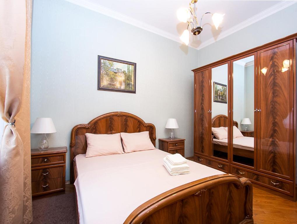 Кровать или кровати в номере ApartLux Tverskaya-Yamskaya