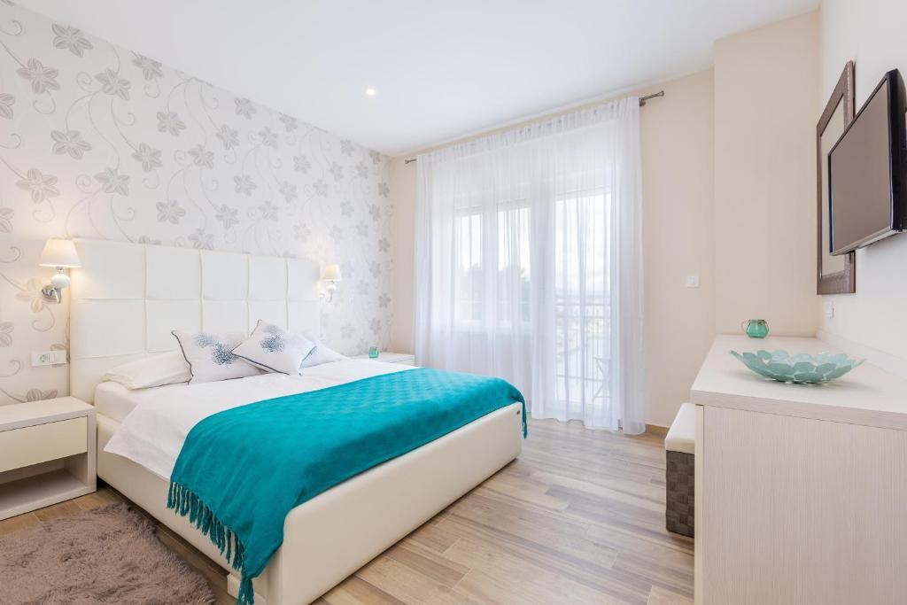 Krevet ili kreveti u jedinici u objektu Apartments & Rooms Milcetic