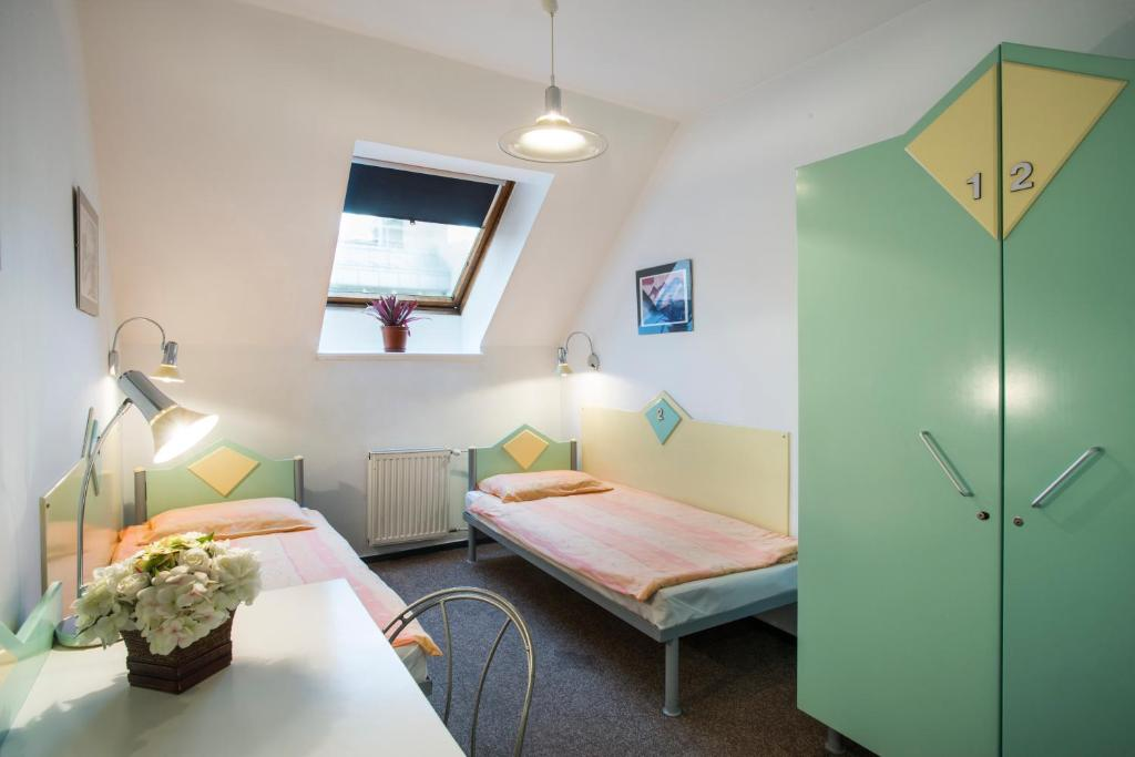 A bed or beds in a room at MP Hostel Budapest