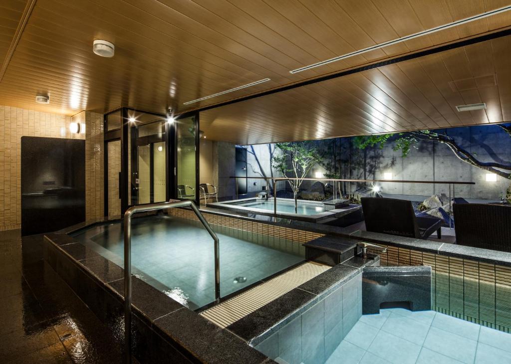 The swimming pool at or near Fukui Manten Hotel Ekimae