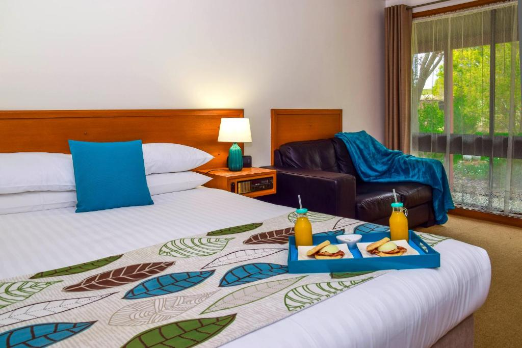 A bed or beds in a room at River Country Inn