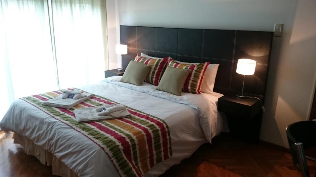 Una cama o camas en una habitación de Temporarios Peatonal