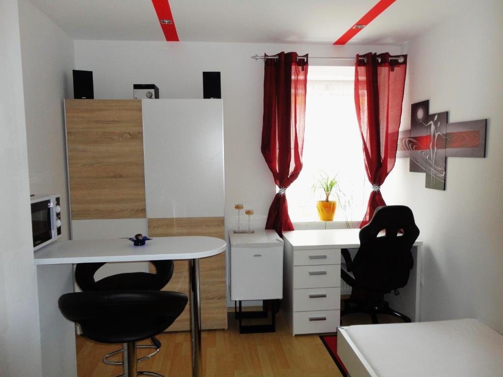 Ein Sitzbereich in der Unterkunft Rentcenter79_2