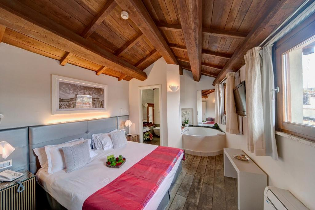 A bed or beds in a room at Navona Palace Luxury Inn