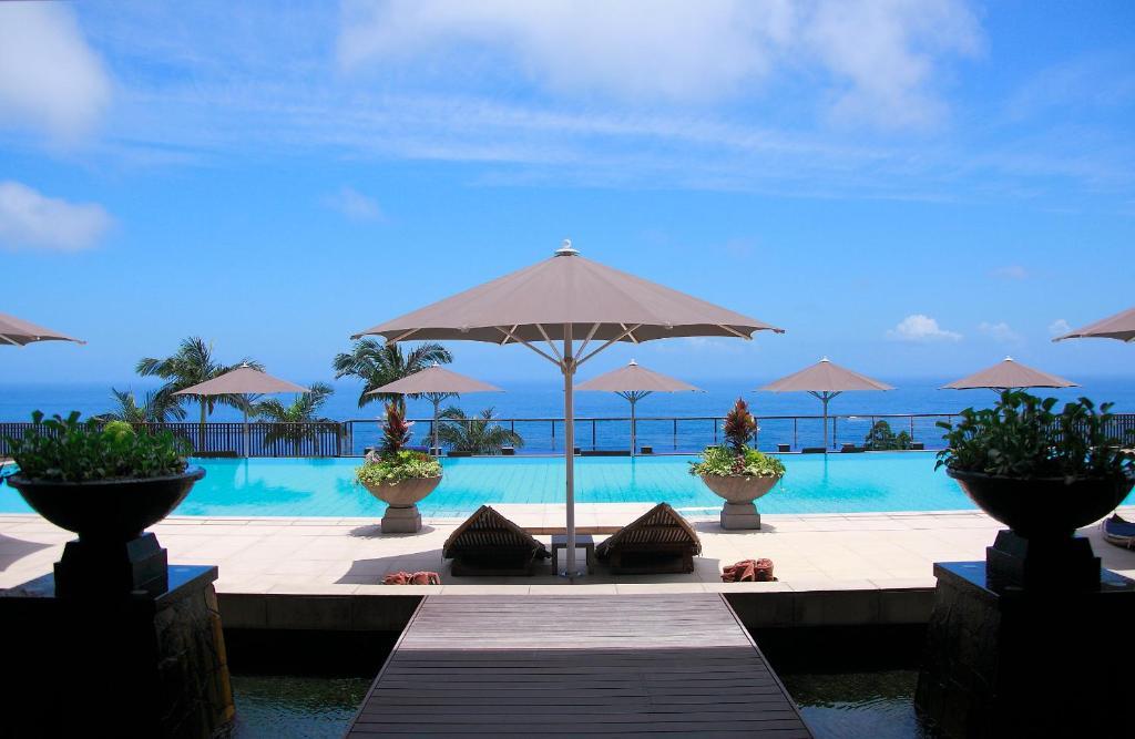 The swimming pool at or near Sankara Hotel & Spa Yakushima