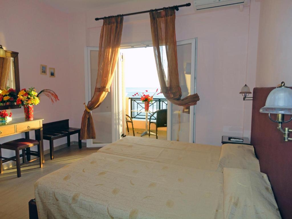 A bed or beds in a room at Galini Sea Apartments
