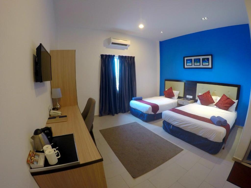 Ein Zimmer in der Unterkunft Royal Agate Beach Resort