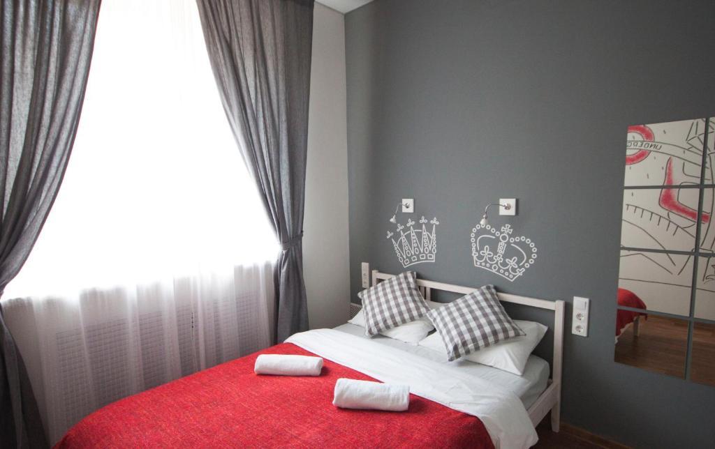 Кровать или кровати в номере Хостел География Казань