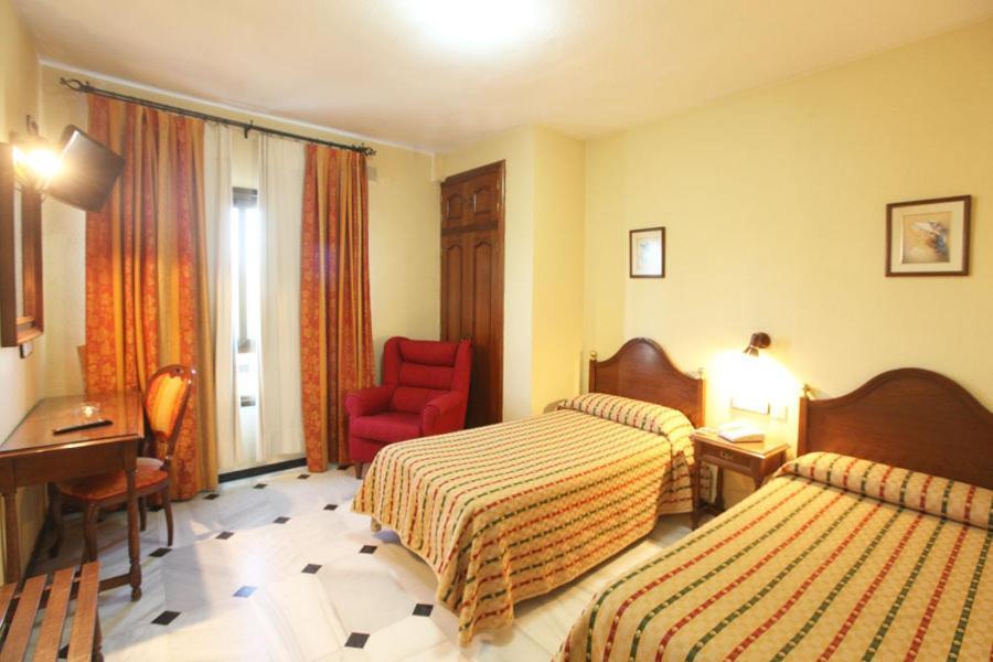 A bed or beds in a room at El Cisne