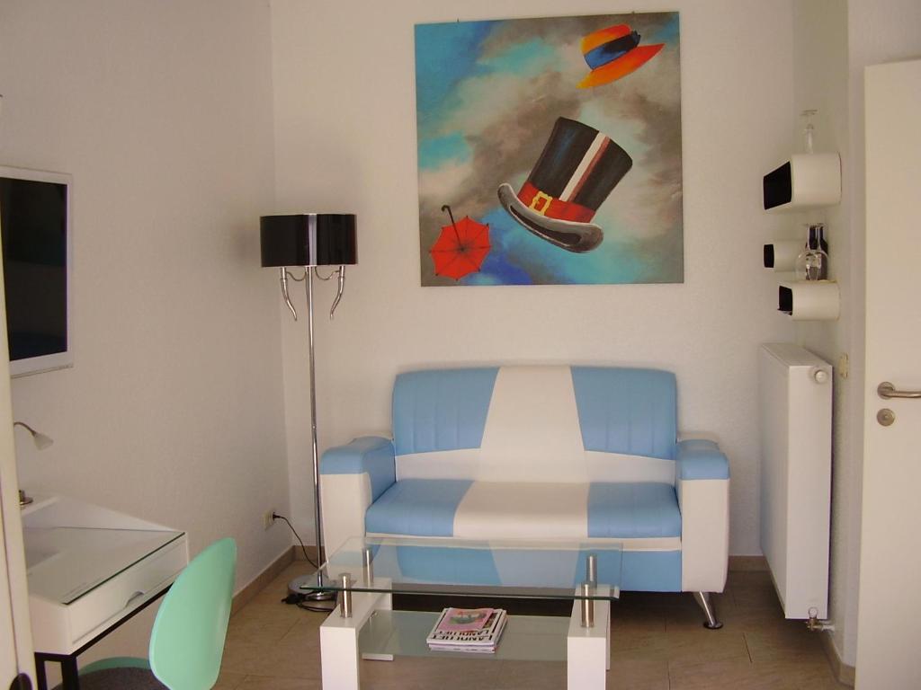 Ein Sitzbereich in der Unterkunft Gästezimmer am Elberadweg