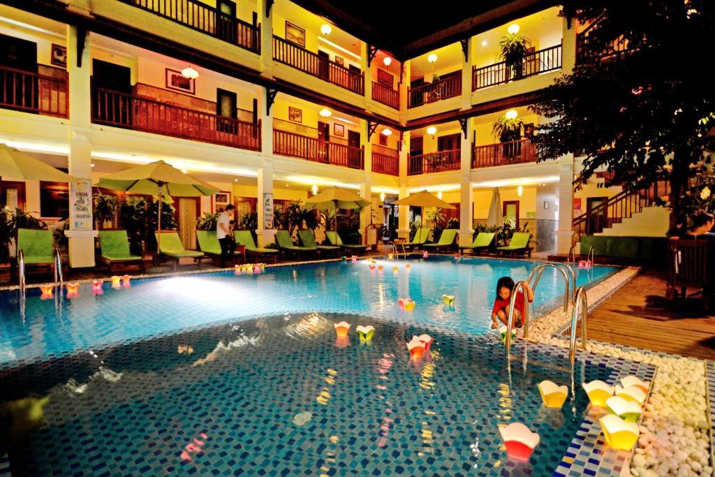 Der Swimmingpool an oder in der Nähe von Green Heaven Hoi An Resort and Spa