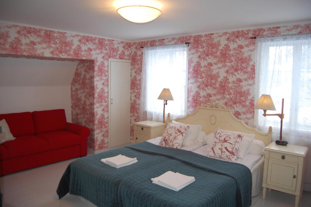 A bed or beds in a room at STF Vickleby Bo Pensionat