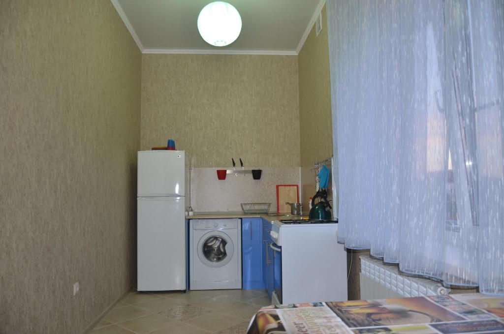 Кухня или мини-кухня в Guest House Tatyana