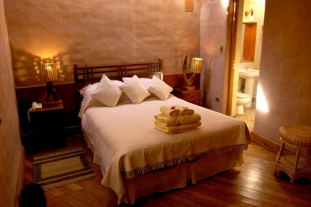 Una habitación en Hotel Kimal