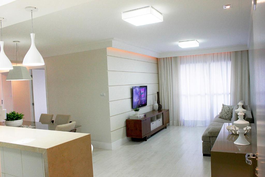 A seating area at Apartamento Luzes do Farol