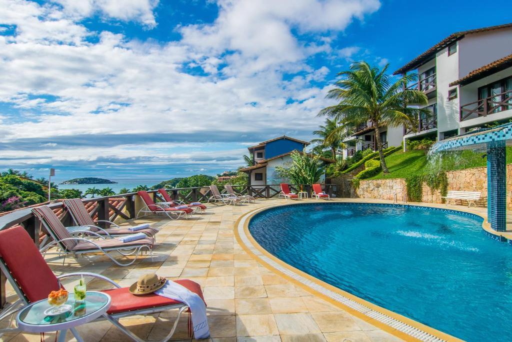 A piscina localizada em Hotel Ilha Branca Inn ou nos arredores