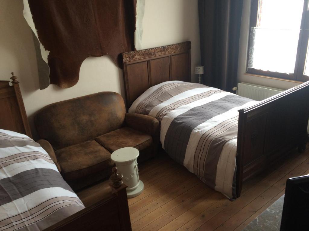 Een bed of bedden in een kamer bij B&B Chez Mémère