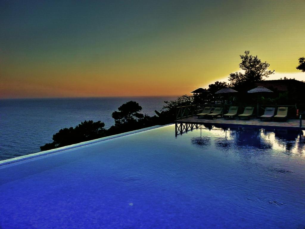 The swimming pool at or near Olive Garden Kabak