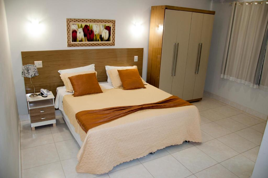 A bed or beds in a room at Gran Norte Hotel Salinas