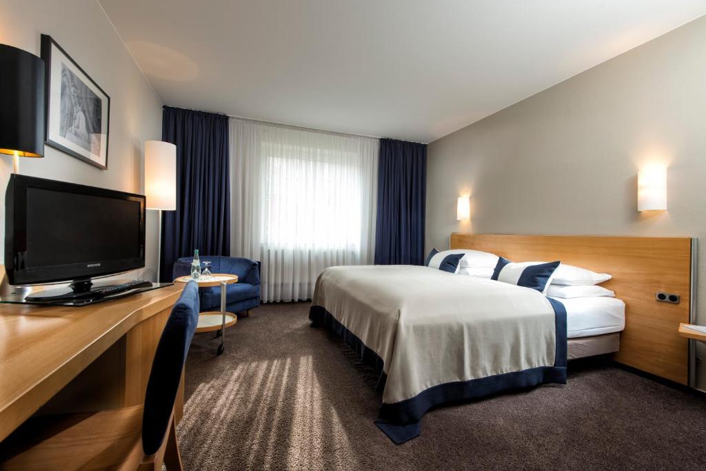 Ein Bett oder Betten in einem Zimmer der Unterkunft Wyndham Garden Potsdam