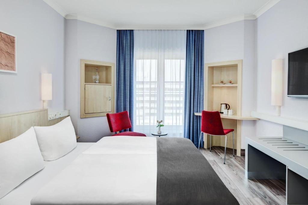 Ein Zimmer in der Unterkunft IntercityHotel Hamburg Altona
