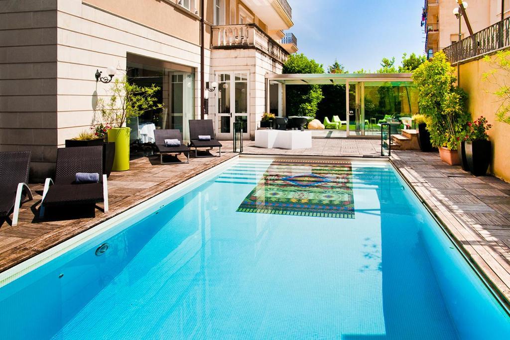 The swimming pool at or near Hotel Villa del Bosco