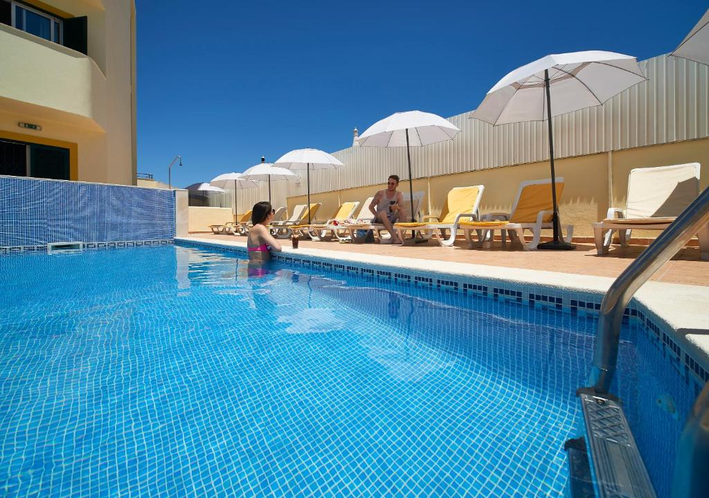 Het zwembad bij of vlak bij Cheerfulway Torre da Aldeia Apartamentos
