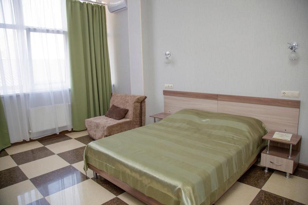 Кровать или кровати в номере Отель Фестиваль