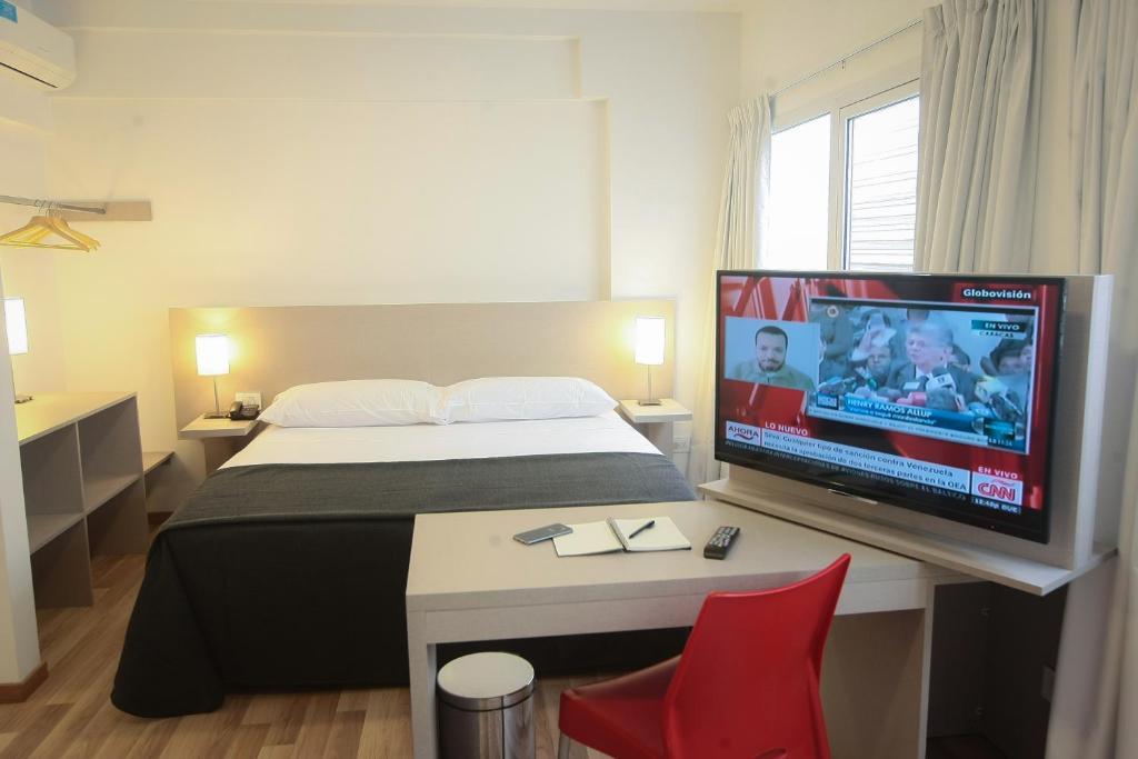 Una cama o camas en una habitación de Buen Pastor Capuchinos