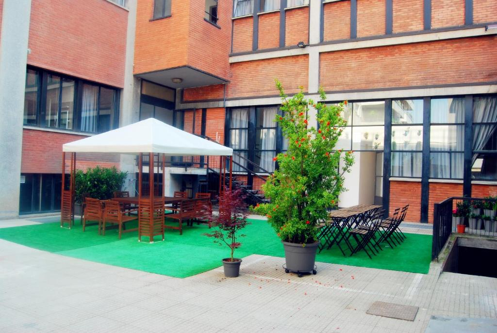 A porch or other outdoor area at Mio Hostel