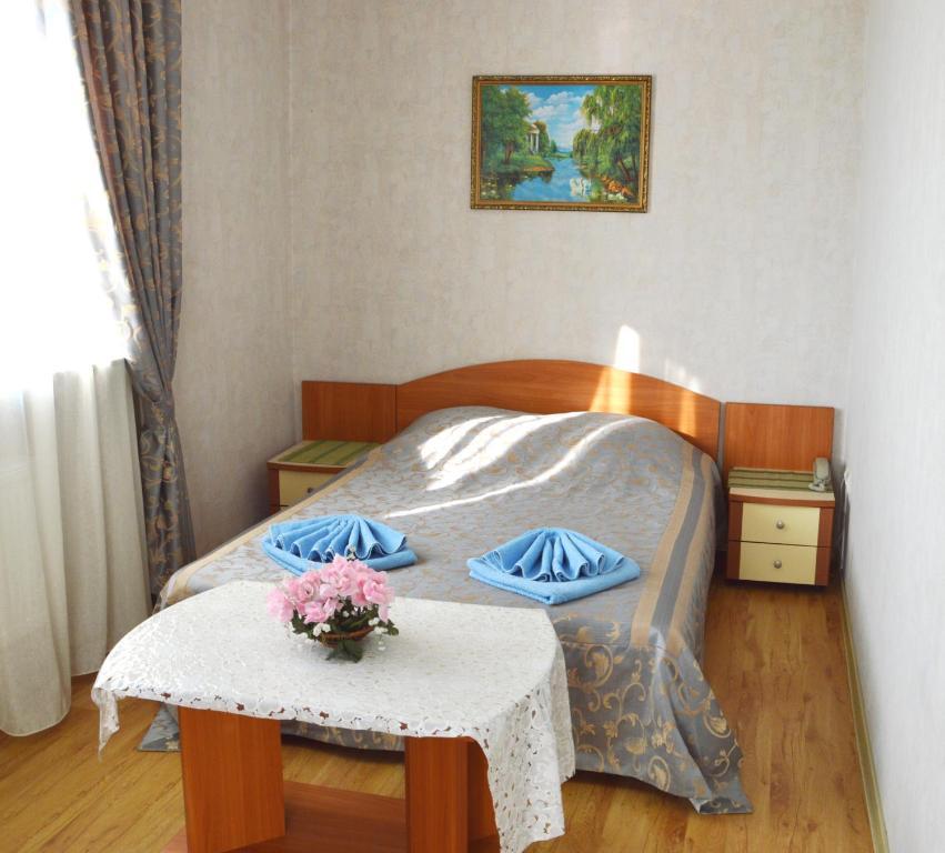 Кровать или кровати в номере ''ANI'' на Северной