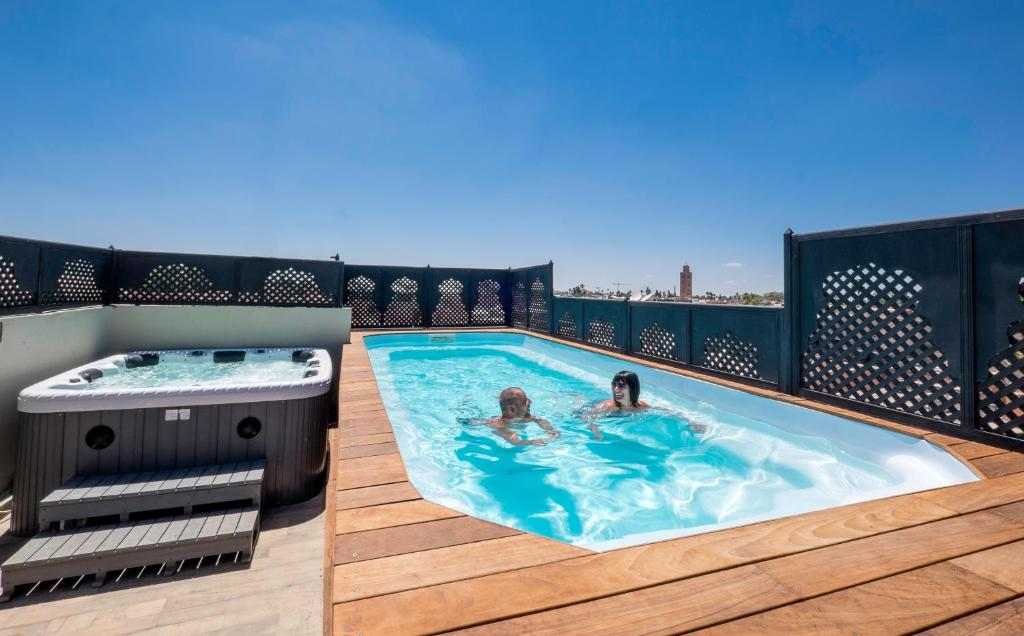 The swimming pool at or near Riad Nesma Suites & Spa
