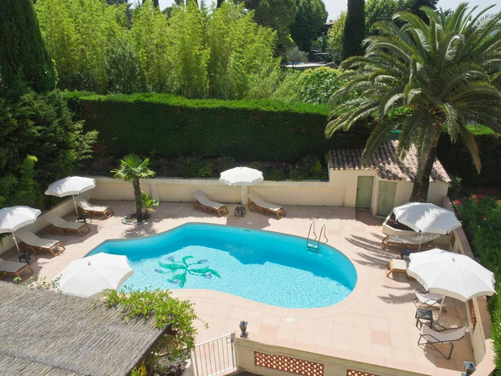 The swimming pool at or near Hotel Les Oliviers