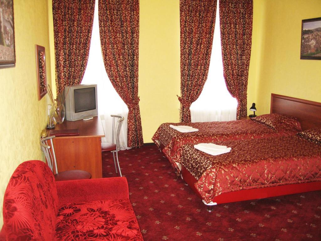 Кровать или кровати в номере OLD TOWN apartments