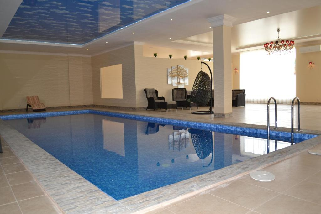 The swimming pool at or close to Grand Hotel &Spa Maykop
