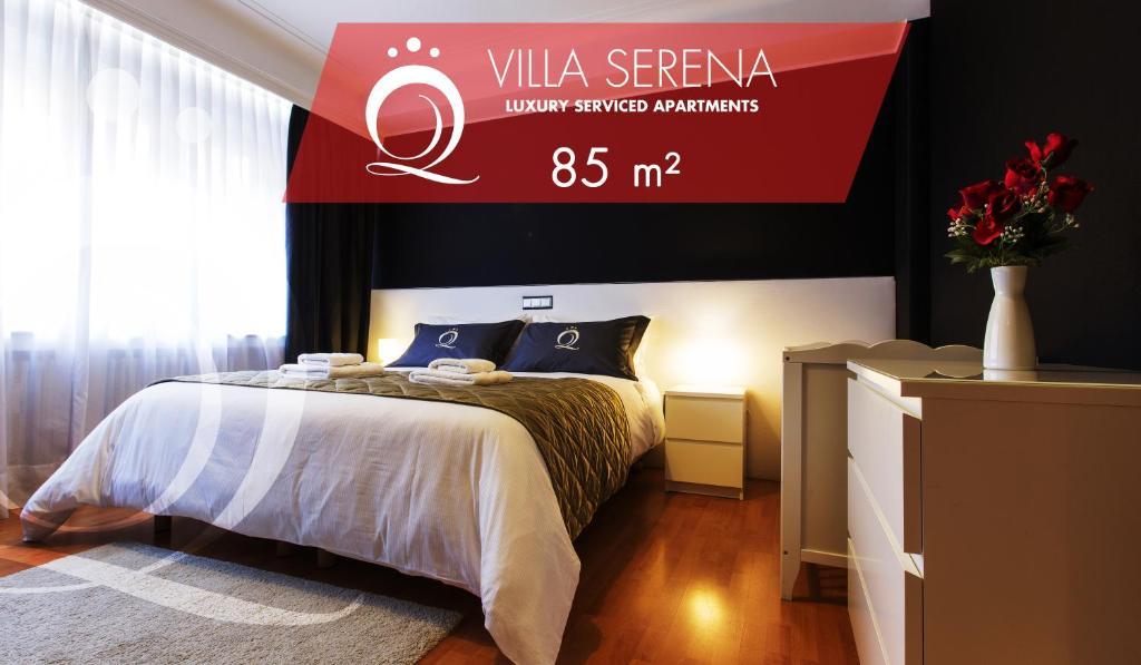 Ein Bett oder Betten in einem Zimmer der Unterkunft The Queen Luxury Apartments - Villa Serena